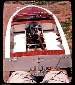 Brian (Lofty) Harris built this bondwood boat from purchased plans. Took four years to complete with working away from home etc. Fitted a direct drive Holden 179 used 6 cyl engine with a ported and polished cylinder head. Had some shaved off it for more compression. Had some ski's behind it on a lagoon out near Condamine S/E Qld. edit