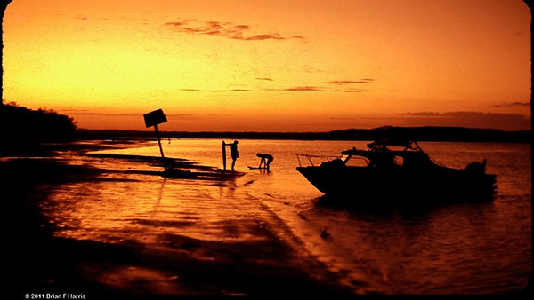 1966 on Coochiemudlo Island in Moreton Bay. The smoothest water is often at sunrise or sunset. This is sunset. Then we light our fire for our camp cooking and effect.