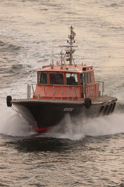 Pilot Boat bringing the Harbor Master to take the Enchantment out of port