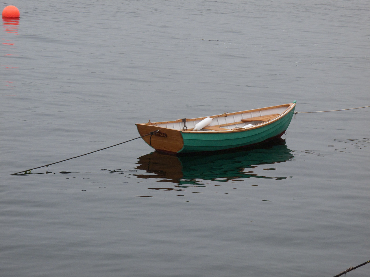 Lone dingy at the edge of the fog