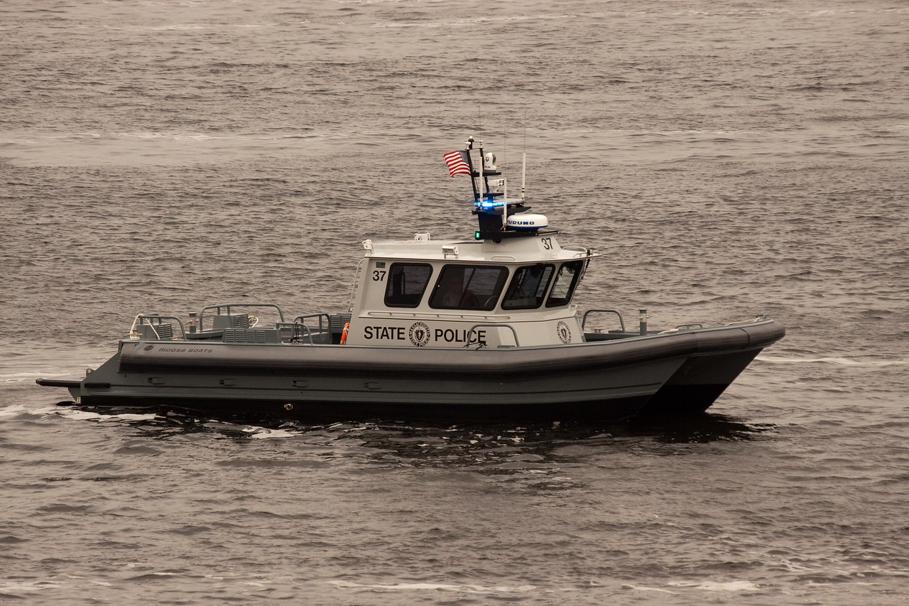 Massachusetts State Police Boat escorting Enchantment out of Boston.