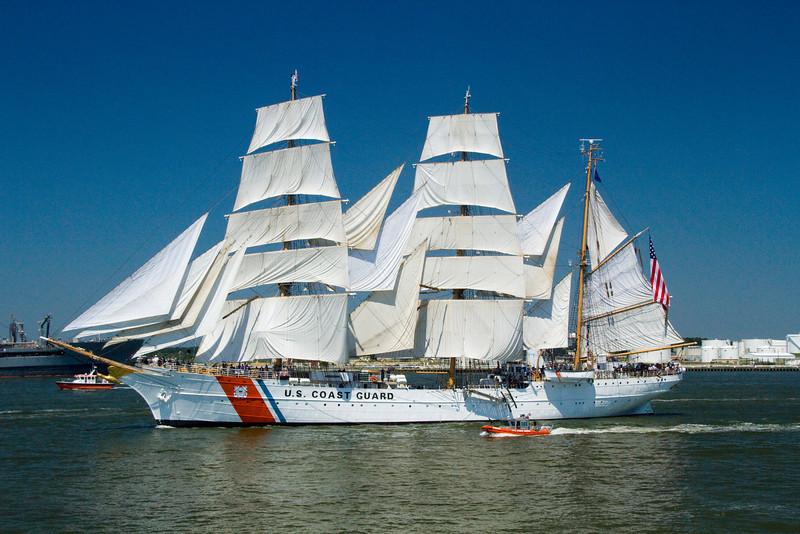 In full sail and full regalia.