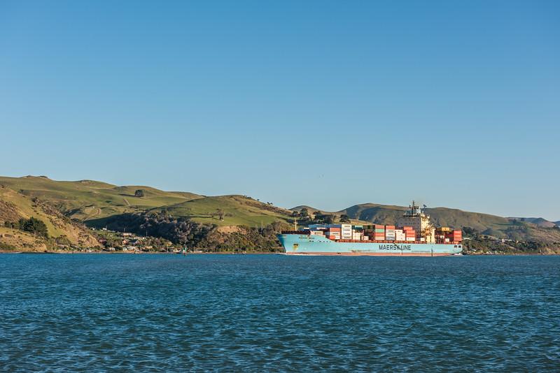 Cargo ship 'Maersk Brani' sails past Aramoana Spit.