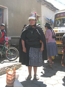 Notice the weaving on her skirt.