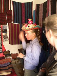 Kjirsten tries on a hat.