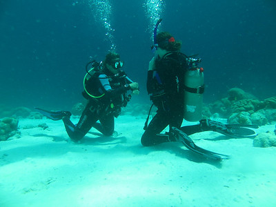 Hayley doing her final certification dive.  Instructor on left, Hayley on right.
