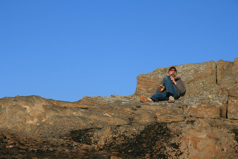 Local sax player practising on top of Daisy Rock