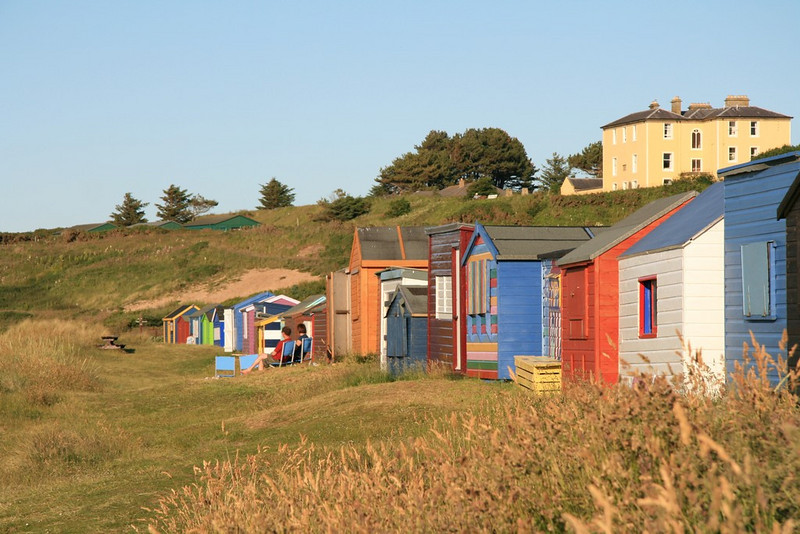 Beach Huts with Hopeman Lodge on the hill at the back.