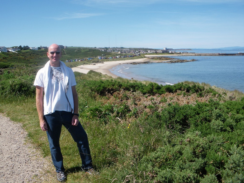 Andy with the East Beach and Hopeman Harbour in the background.