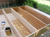The first of two coats of varnish — Minwax clear satin polyurethane.