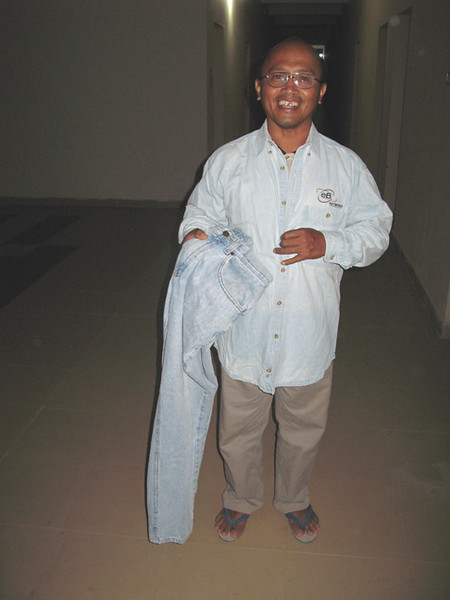 Fr. Kus shows off his new pair of pants.