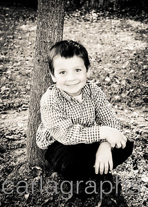 connor sitting under tree bw-1