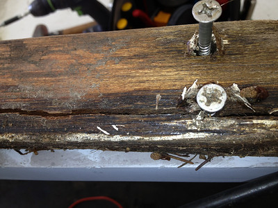 ROTTEN WOOD CLAMPS THAT ATTACHES STEERING CONSOLE TO DECK