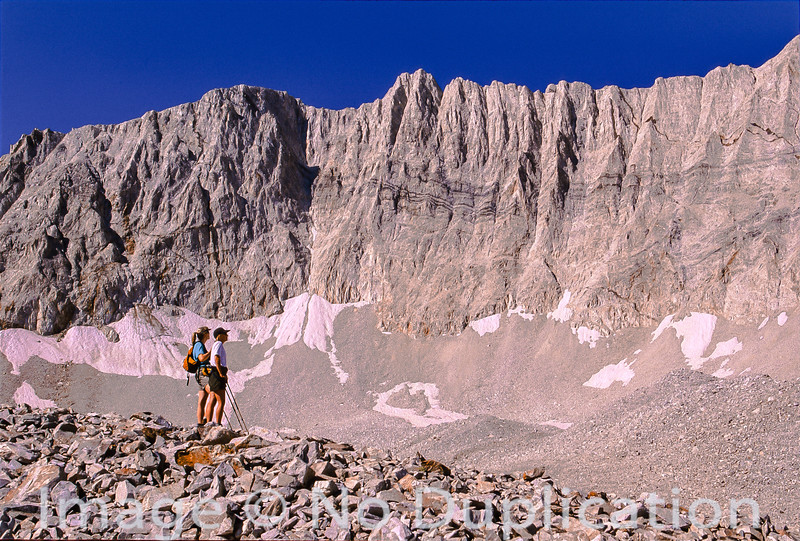 Two hikers stand in awe of D.O. Lee Peak in the White Cloud Mountains, Idaho.