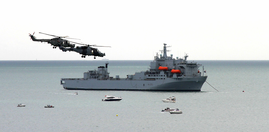 RFA Argus and two of the Royal Navy Blackcats helicopter display team