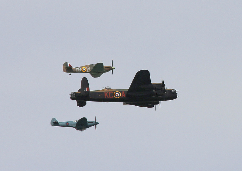 The RAF Battle of Britain flight; top is a Hawker Huricane, middle is the Avro Lancaster, and below is the familiar shape of  a Supermarine Spitfire.