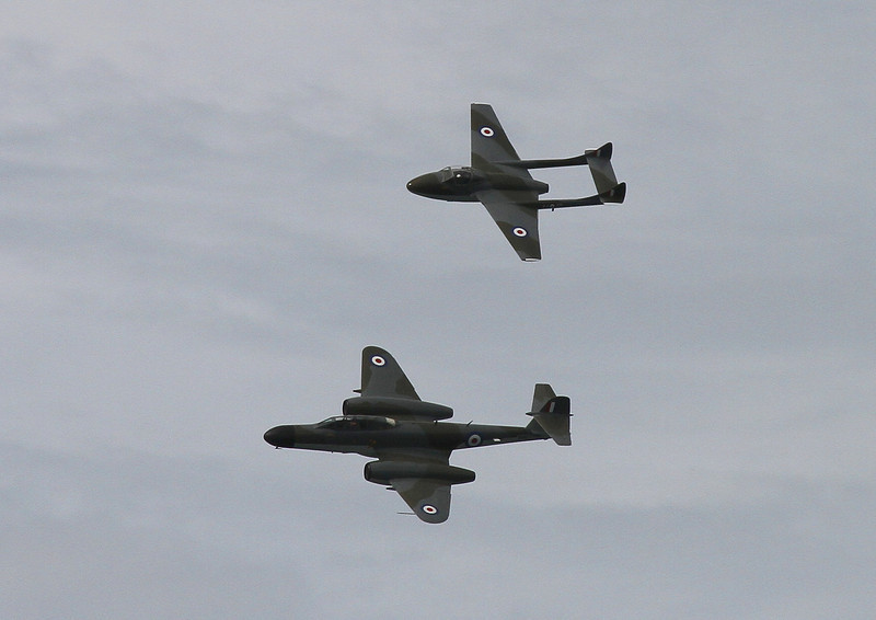 From the fifties, a DeHaviland Vampire and a Gloster Meteor NF11 fly in formation.