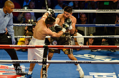 MIKEY GARCIA (right) defends his featherweight world champion title against JUAN CARLOS MARTINEZ (left). GARCIA won the fight in the fourth round on a TKO.