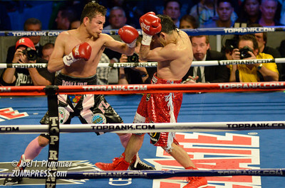 NONITO DONAIRE (left) and OMAR NAVAREZ (right) fight for the bantamweight unified championship of the world at Madison Square Garden.