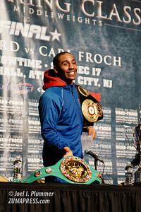 ANDRE WARD displays his belts for the press after his unanimous decision victory over CARL FROCH.
