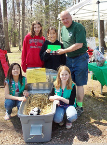 Members of Junior Troop 11140, Marlaina Garczynski, Anna Whiteley, Emily Hamlon and Malia Gatto with Kevin Zimmers are the Trash to Treasure contest.  This project is to earn their Bronze Award.