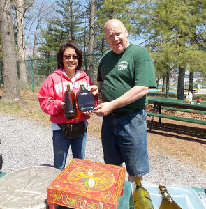 Kevin Zimmers with Marcie Gatto, winner of the Trash to Treasure contest. Gatto turned wine bottles into trays.