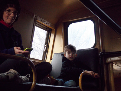 Sharon Marcheskie rides the caboose with her grandson.