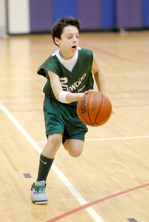 Carson Slaven brings the ball down court for Edgewood.