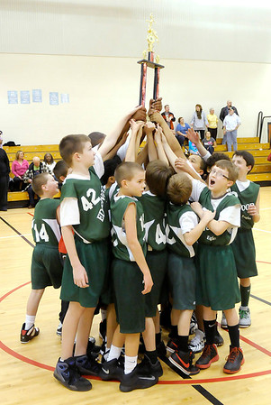Edgewood hoists their trophy in the air.