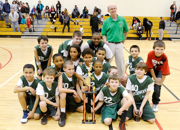 Edgwood poses for a team photo with their city tournament trophy.