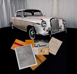Documents on floor in front of car-2