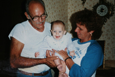 Mom amd Dad with Amanda at 5 months 1984.