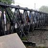 Note railroad rails supporting bridge