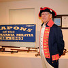 Revolutionary War reenactor with his collection of weapons