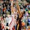 Don Knight / The Herald Bulletin<br /> Anderson's Grant Bennett shoots as he is guarded by Brebeuf's Aaron Banks on Tuesday.
