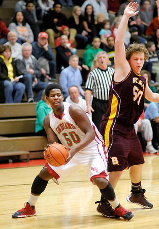 Don Knight / The Herald Bulletin<br /> Anderson's Kobe Clay gets around the defense of Brebeuf's Tanner Webster on Tuesday.