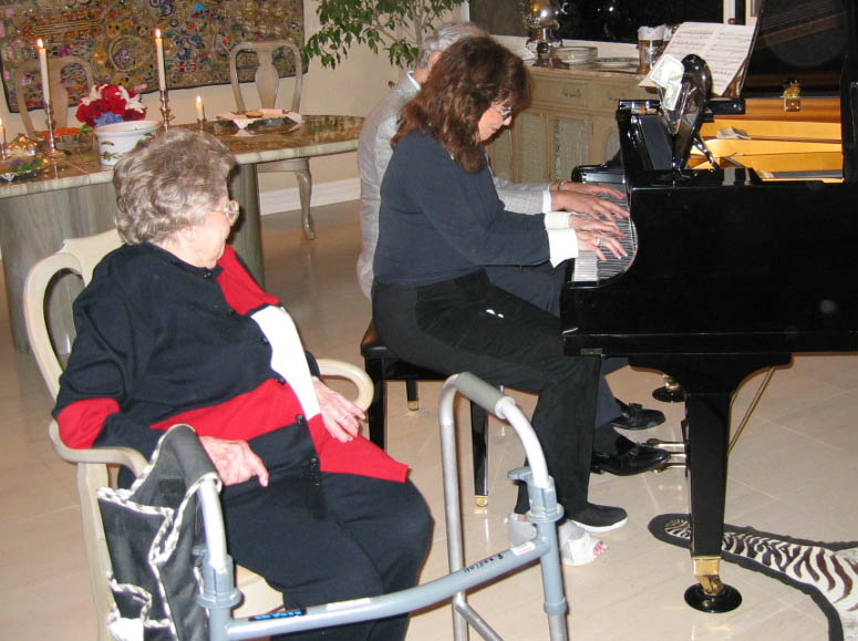 Jackk and Arlene playing a duet on the piano.  Mama made them do it.