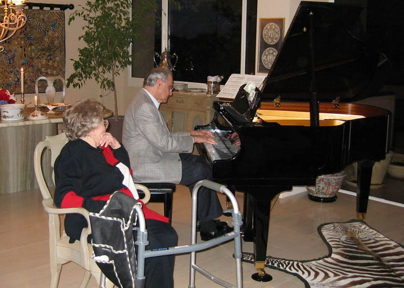 Jack playing the piano.  Hes pretty good as usual.  Mama really enjoyed it.