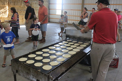 Local residents and visitors sample a locally-made breakfast and tour the Wheeler Dairy Farm, Saturday, Aug. 15 in Breckenridge. The event is aimed to educate non-farming individuals on the modern agriculture industry, and hosted 70,000 visitors at different farms each year since it began in 2009.