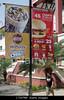 Choice 6 of 7<br /> <br /> C7WTMP Nicaragua Managua Avenida Simon Bolivar Plaza Inter street scene Hispanic man walking sign banner advertising marketing promotio