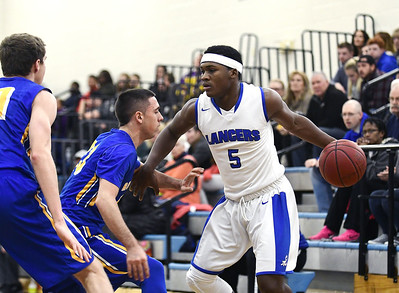 12/31/2016 Mike Orazzi | Staff Bristol Eastern's Roderick Jenkins (5) during Saturday boys basketball game with Rockville in Bristol.