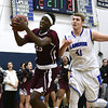 1/20/2017 Mike Orazzi | Staff<br /> Bristol Central's Jaekwon Spencer (25) and Bristol Eastern's Thomas Gonzales (41) during Friday night's basketball game at BE.