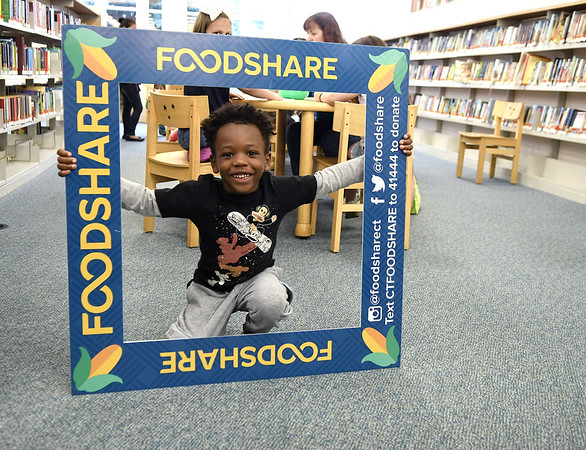 7/14/2017 Mike Orazzi | Staff Jermaine Jenkins while attending a Food Share event at the Bristol Public Library Friday morning.