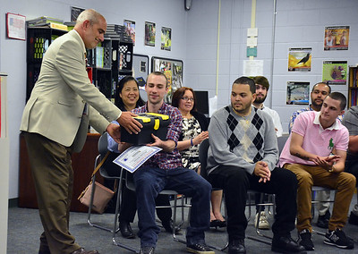 6/7/2016 Mike Orazzi | Staff Larry Covino, supervisor of Bristol Adult Education, presents Workforce participant Alex Williams a toolbox during a ceremony at the Bristol Adult Education on Tuesday afternoon.