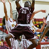010316  Wesley Bunnell | Staff<br /> <br /> New Britain boys basketball vs visiting Bristol Central at New Britain High School on Tuesday Jan 3.  Bristol Central's Jackwon Spencer (25), New Britain's Maurice Turner (20) and Gabe Yopp (44).