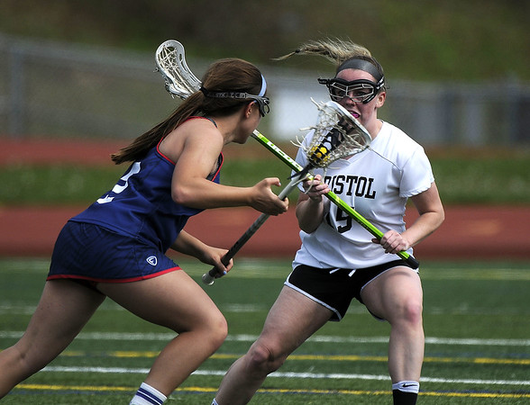 5/6/2017 Mike Orazzi | Staff St. Paul Catholic High School's Catherine Ciampi  (2) and Bristol Coop Girls Lacrosse's Meghan Hamel (15)  Saturday at Bristol Eastern.