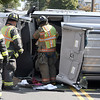 9/26/2017 Mike Orazzi | Staff<br /> Bristol firefighters while extricating the driver of a van involved in a rollover crash on Woodland Street in Bristol Tuesday morning.