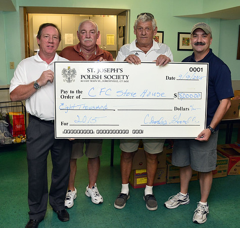 9/9/2015 MIke Orazzi | Staff St. Josephs' Polish Society members Bob McFadden, Art Bissell, Dennis Brown present an $8,000 check to Dean Desjardins of the pastor of the Christian Fellowship Center in Bristol on Wednesday morning.