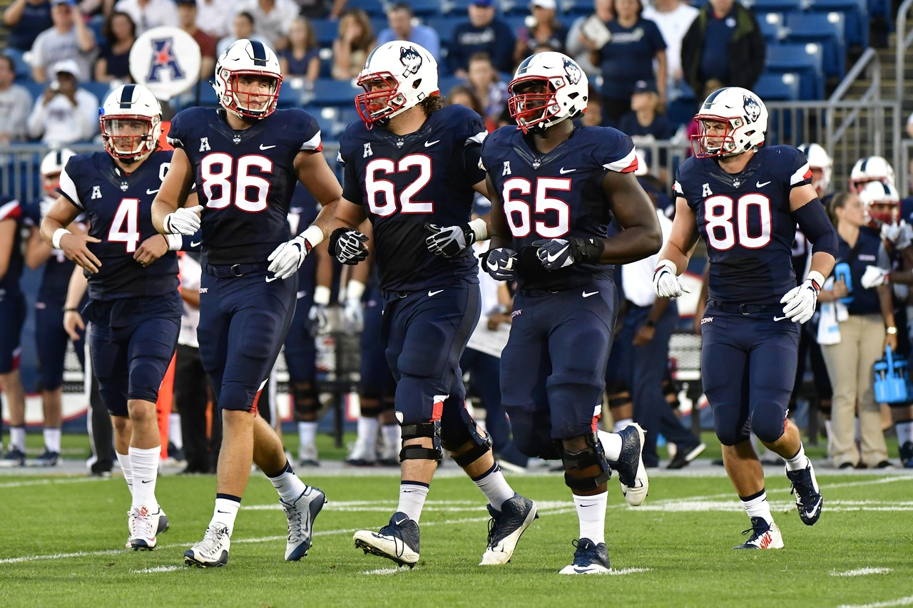 9/1/2016 Mike Orazzi | Staff UConn's Bryant Shirreffs (4), Alec Bloom (86), Thomas Hopkins (62), Matt Peart (65) and Tommy Myers (80) during a 24-21 UConn win at Rentschler Field in East Hartford Thursday night in the season opener.
