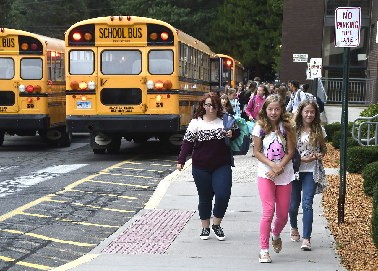 8/31/2017 Mike Orazzi | Staff Students arrive for the first day of school at the Eli Terry Middle School in Plymouth Wednesday.